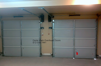 Photo: Unusual Door installation. This door has a beam that prevents a normal operator from being used. The LiftMaster 3800 solves the problem. This trolley type operator is mounted in the upper corners of the wall and does not take space in the center of the garage. Call us today to addresss your garage door needs. Cedar Park Overhead Doors 512-335-7441