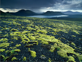Photo: Landmannalaugar, Iceland  Dead volcanos, calm lakes, lava fields and vivid mosses are typical for sceneries one can experience near Landmannalaugar.  With the average of 213 rainy days a year, it may seem uneasy to pick on a good photographic weather in Iceland and I was afraid of having to sit and wait for opportunities for a heft of time of our week-long visit to there. The reality proved the opposite. Yes, there were days when changing from rain to sunshine to dizzle was a matter of minutes. But actually these days provided for countless chances to press the shutter if our equipment handled to withstand some more water than usually, which was not always the case. Thanks to rather fantastical and almost bizzare character of landscape, it was sometimes a must to shoot while it was raining to create moody images that may work.