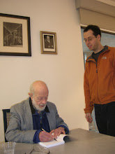 Photo: Erich signing Elchanan's copy