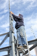 Photo: Test complete, system working, Garth re-installing the antenna