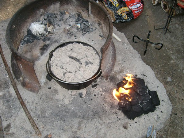 Before you start, always preheat your Dutch oven.  Start a bunch of coals...