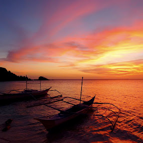 sunset in the Philippines by Fred Goldstein - Landscapes Waterscapes ( clouds, sunset, boats, sea, philippines,  )