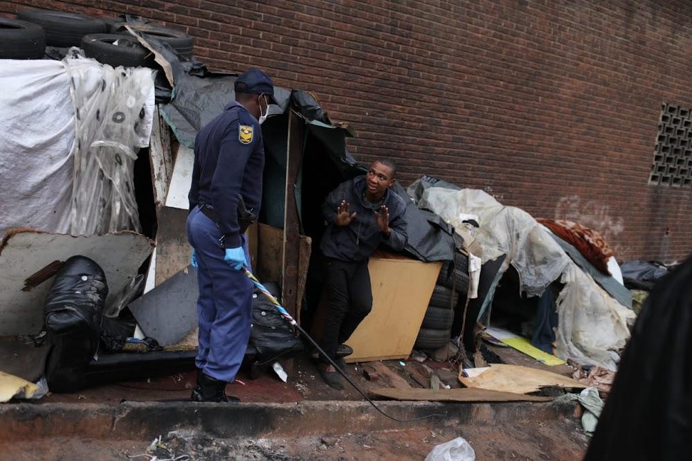 Police threaten Hillbrow's homeless with sjamboks to enforce national lockdown