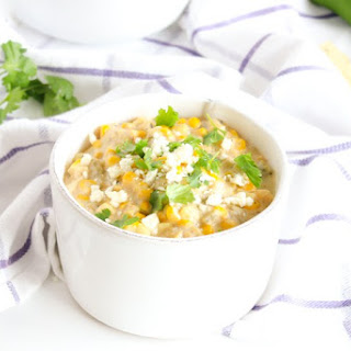A creamy, healthier slow cooker corn dip with roasted green chiles. It's the perfect appetizer for game day tailgating!