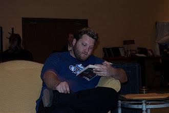 Photo: Garney is reading a very engrossing book at every rehearsal.