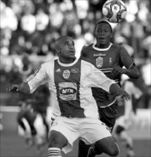 LOCKED ON: Ajax Cape Town's Salie Tawfeeq fights for the ball with Pretoria University's Thokozani Sekotlong in their Nedbank Cup semifinal match at Milpark Stadium in Johannesburg on Sunday. AmaTuks beat Ajax 2-1 in extra time. 27/04/09. Pic. Antonio Muchave. © Sowetan.