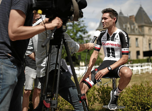 World champion: Tom Dumoulin of the Netherlands faces the media at Wednesday's pre-Tour presentation. Reuters