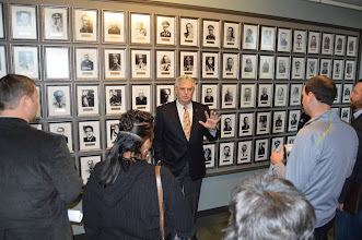 Photo: Foundation CEO Doug Tystad talks to chamber board members about the CGSC International Hall of Fame (IHOF) gallery where the photos of international officer graduates of CGSC who have been inducted into the IHOF are displayed.