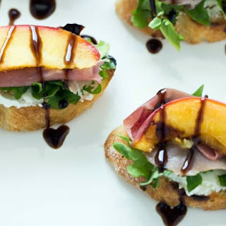 Grilled Peach Crostini with Arugula, Prosciutto and Goat Cheese