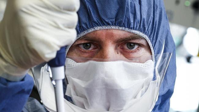Scientist in lab using a pipette