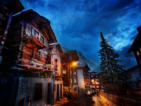 Photo: The Streets of Zermatt  After dinner one evening, I went out with my iPod to explore the streets alone. There was a light cool rain, but it didn't bother me a bit. It added to the mood and everything felt great. The warm cabins, the cool sky, the wet streets, people hurrying to and fro to get warm food and drinks... I do my best to capture this feeling all in one image.  from Trey Ratcliff at http://www.StuckInCustoms.com