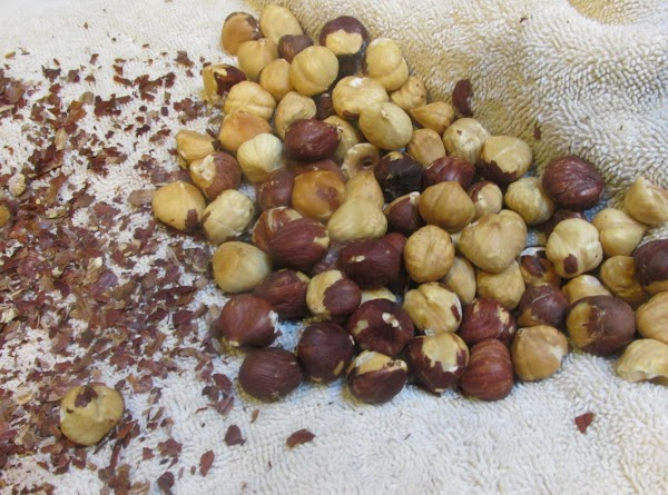 After 10 minutes has elapsed, leave nuts covered and rub back and forth between...