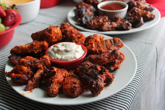 Photo: The wings didn't last long, some homemade blue cheese dressing for dipping. We put out some extra BBQ sauce for the Honey BBQ wings but no one even touched it. The wings were so good on their own.