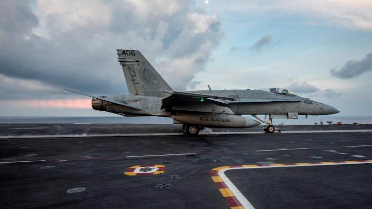 An F/A-18C Hornet from the Strike Fighter Squadron (VFA) 34 'Blue Blasters' launches from the aircraft carrier USS Carl Vinson (CVN 70) flight deck, in South China Sea. US Navy photo by Mass Communication Specialist 3rd Class Matt Brown/Handout via REUTERS