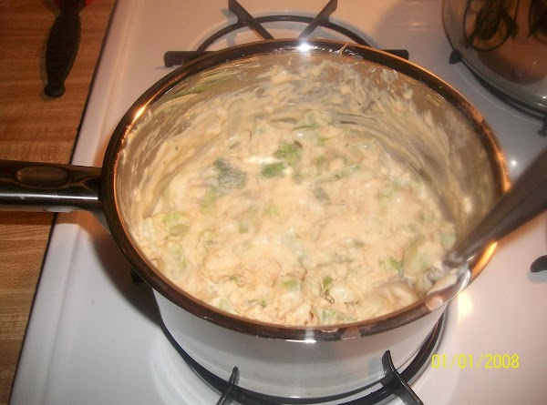 Mix remaining onions, broccoli, cream cheese, and bell pepper in large dutch oven. ...