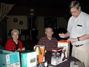 Photo: Gertrude & Paul Smith W7EKG - in charge of the raffle tickets