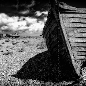 Dungeness  by Leigh Brooksbank - Landscapes Beaches ( beached, black & white, derelict, boat, dungeness )