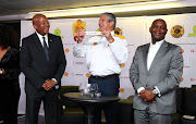 Bobby Motaung, Football Manager of Kaizer Chiefs, Anton Niemann, Shell Downstream SA General Manager (c) and Pitso Mosimane, Coach of Mamelodi Sundowns conduct the draw during the launch of the 2018 Shell Helix Ultra Cup presented by SMSA at FNB Stadium, Johannesburg on 28 May 2018.
