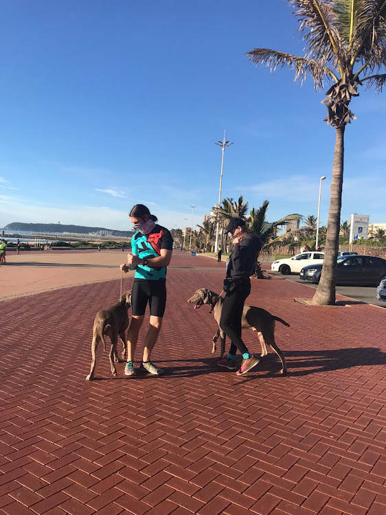Jack and Jeanie Le Grange with Waldo and Klaus on the Durban promenade.
