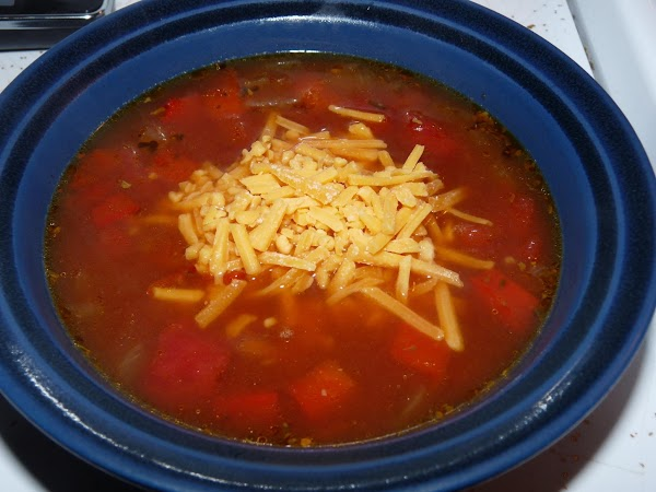 To serve, garnish with shredded cheddar and parsley (optional). Crusty buttered bread is a...
