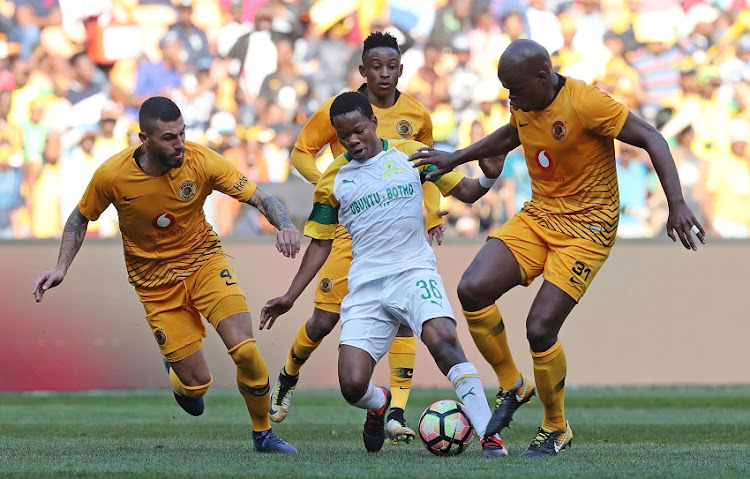 Sphelele Mkhulise of Mamelodi Sundowns challenged by Willard Katsande and Daniel Cardoso of Kaizer Chiefs during the 2018 Shell Helix Cup match between Kaizer Chiefs and Mamelodi Sundowns at the FNB Stadium, Johannesburg on 21 July 2018.