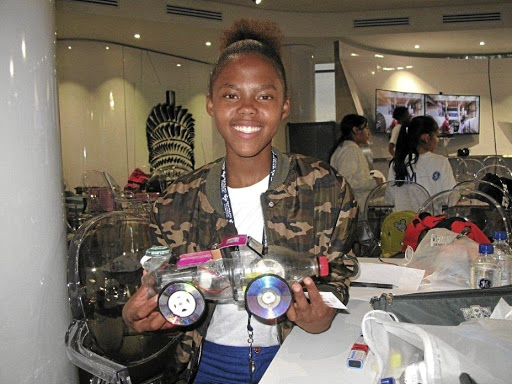 Young engineer: Kamogelo Sihlangu, a Grade 10  pupil from Ivory Park Secondary School in Midrand, shows off her programmable electric vehicle in Houghton on Friday. Picture: MARK ALLIX