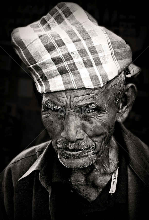 Shy Old Timer. by Ian Gledhill - People Street & Candids ( market, black and white, thailand, asia, old man, pwcemotions, shy, portrait, face, people, pwc faces, people. portrait, street, portraiture, b&w, city, photography,  )