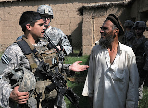 Photo: KUNAR PROVINCE, Afghanistan - U.S. Army 1st Lt. James D. Horne of Fayetteville, N.C., a platoon leader with Company A, 2nd Battalion, 327th Infantry Regiment, Task Force No Slack, talks to a resident of Lar Sholtan village in eastern Afghanistan's Kunar province Aug. 21. Two months previously, a female suicide bomber killed two Soldiers with the unit, seriously wounded two others, three Afghan police officers and at least five children at the village. This marked the first visit to the community by International Security Assistance Forces since the attack. (Photo by U.S. Army Staff Sgt. Gary A. Witte, 300th Mobile Public Affairs Detachment)