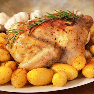 Roast chicken with Lemon, Potatoes & Rosemary