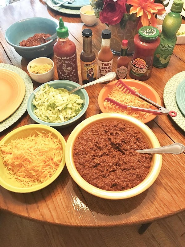 Prepare the condiments for tacos. Once you have condiments ready put the taco meat...