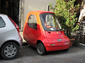 Photo: Smarter than a Smart car, there are many 3 wheel, 1 or 2 passenger cars available here.