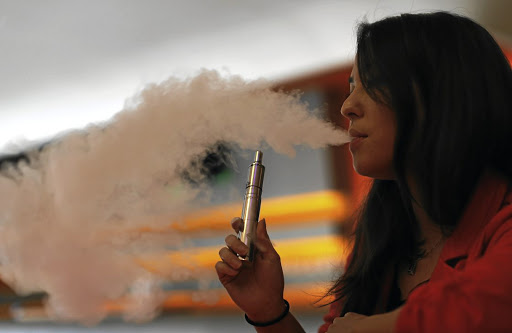 Puff love:  The jury is still out on whether vaping is safer than smoking tobacco cigarettes. Picture: REUTERS