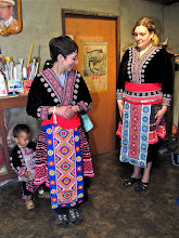 Photo: admiring each other's Hmong outfits