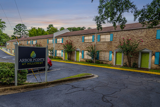 Arbor Pointe at Hillcrest property entrance with sign at dusk