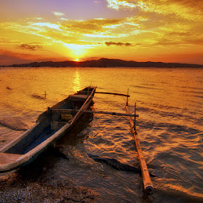 into the golden sunset by Rob Reyes - Transportation Boats