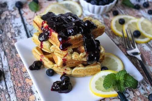 """Lemon Poppy Seed Waffles With Blueberry Sauce""""Light and yummy waffles that go..."""