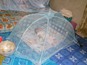 Photo: Mosquito net protecting baby (May 2013)