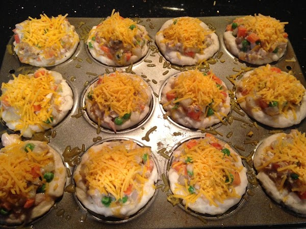 REMOVE PAN FROM OVEN N TOP EACH MUFFIN WITH A TBLSPN OF CHEDDAR CHEESE...