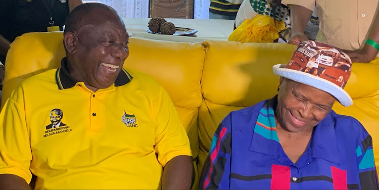President Cyril Ramaphosa shares a laugh with a woman during his door to door campaign in Vosloorus on Tuesday.
