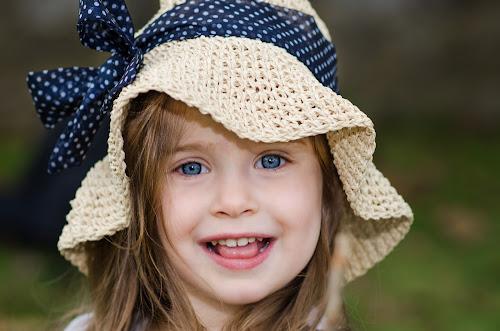 Cute Girl by Renee Crabtree - Babies & Children Child Portraits ( child, blue, smile, portrait, hat )