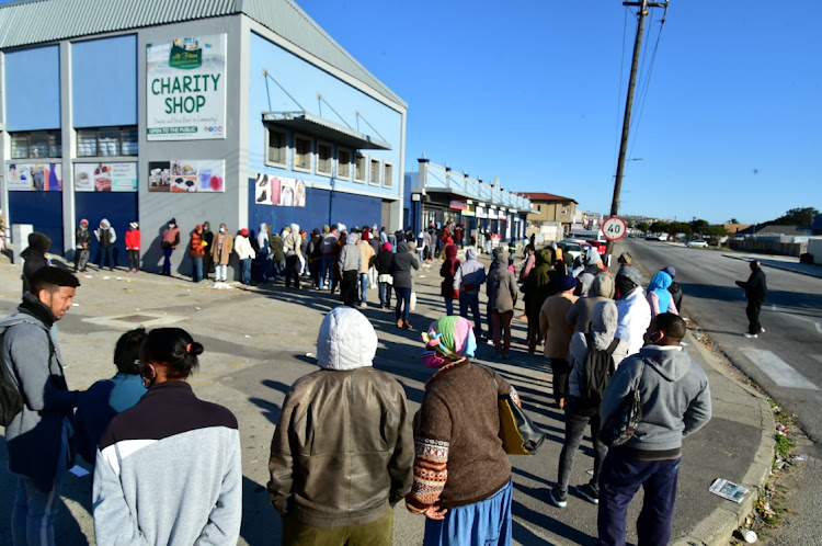 People in line to collect their R350 unemployment relief grant. Stats SA says 565,000 of the 594,000 people believed to have lost their jobs between December 2019 and December 2020 were full-time employees. File photo.