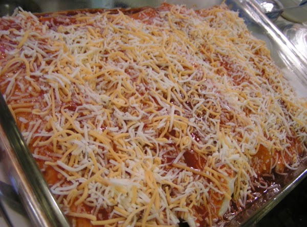 Fill the tortillas with about 3 to 4 heaping tablespoons of the hot chicken...