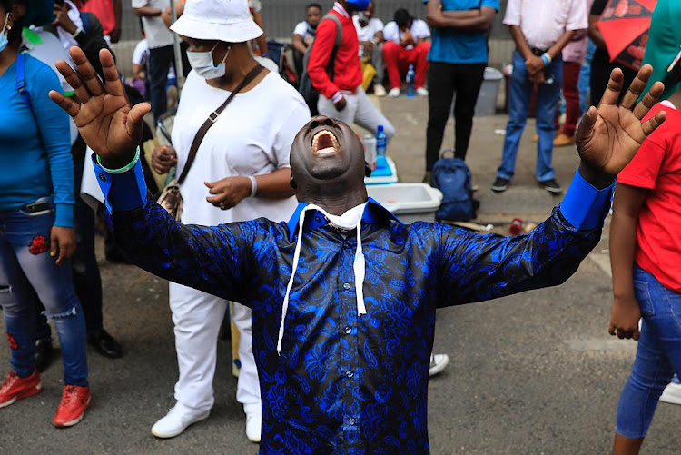 A member of the Enlightened Christian Gathering church celebrates after bail was granted to Shepherd Bushiri and four co-accused on Wednesday.