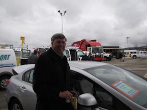 Photo: Medford City Council Member Al Densmore surveys a Honda Civic at the vehicle show.