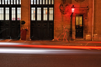 Photo: Fire station in Paris with an old red lantern. Man with the dog hand drawn. The one legged red dog - Light painting by Christopher Hibbert, french photographer and light painter. Further information: http://www.christopher-hibbert.com