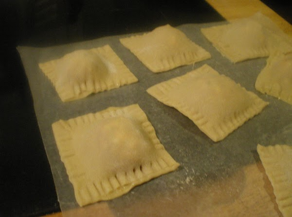 Use a fork to seal edges of ravioli.