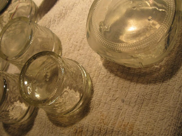 About five minutes before you need them, take jars out with tongs, one at...