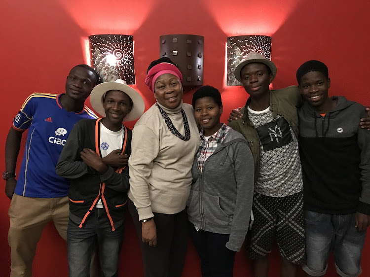 Gcina Mhlope and the now grown-up storytellers who dreamed up Liyana as children.