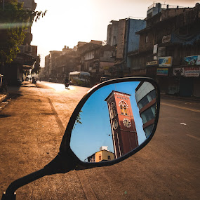 It's not what you look at that matters, it's what you see. by Mitul Gajera - City,  Street & Park  Street Scenes ( #see #through #mirror #light #shine #sun #light #perspective #clock #tower #amazing )