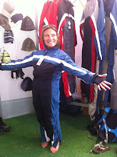 Photo: Colleen trying on flight suits and this one fit